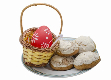 Multicolor painted easter eggs with cookies on plate photo