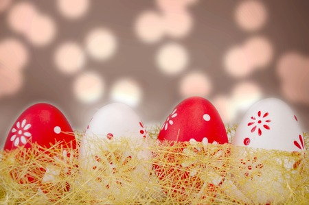 Multicolor painted easter eggs with bokeh efects photo