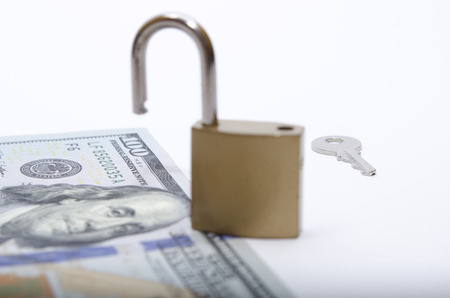 dollar bill with padlock as a concept of money safety