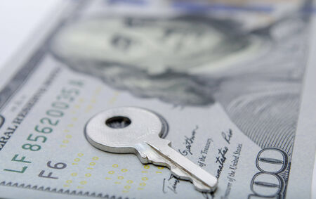 padlock shut off: dollar bill with padlock as a concept of money safety
