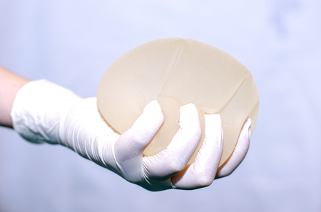 Silicone breast implant for breast augmentation in plastic surgery Stock Photo