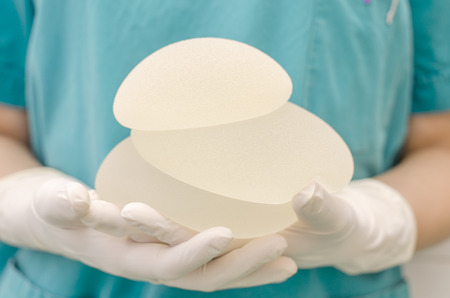 breasts: Silicone breast implant for breast augmentation in plastic surgery Stock Photo