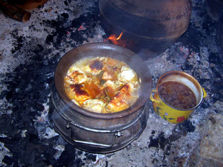 brawn: Traditional dish, sauerkraut in a crock on an ember