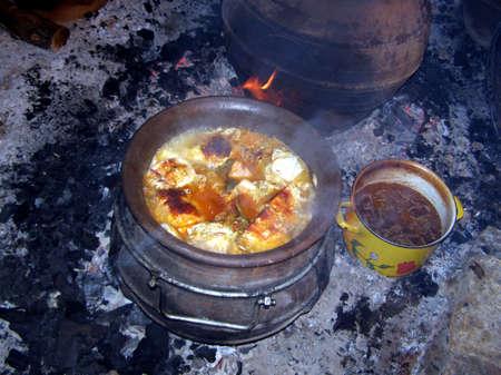 ember: Traditional dish, sauerkraut in a crock on an ember