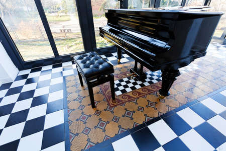 checkerboard backdrop: black and white floor in the galery, note shallow depth of field