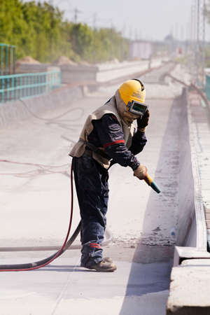 blasting of concrete, note shallow depth of field Stock fotó - 84632264
