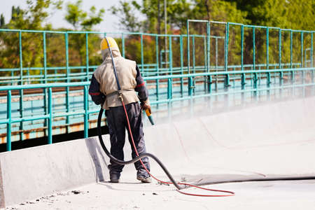 blasting of concrete, note shallow depth of field Stock Photo - 84632076