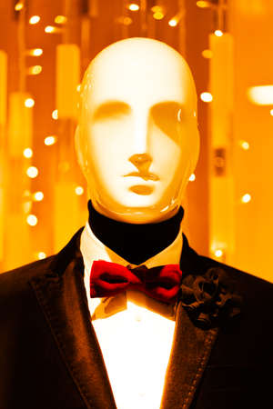 Male fashion mannequin with bow portrait; note shallow depth of field