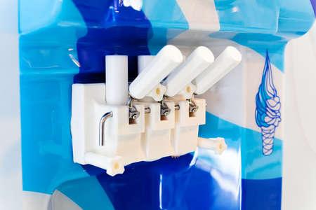 Closeup of hand grips of blue ice cream machine Stock Photo