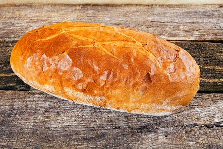 Fresh homemade bread on wooden background