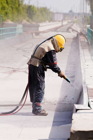 blasting of concrete, note shallow depth of field Stock Photo - 84798761