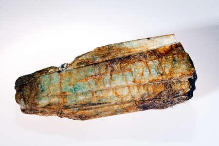 Green beryl aquamarine gemstone isolated on white background