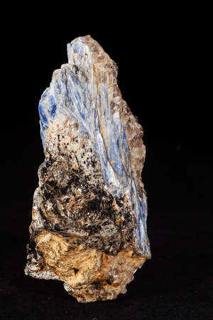 kyanite mineral with garnets on the black  background Stock Photo