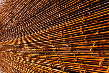 Closeup of rusty steel structure bars on the rack at costruction site