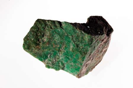 jadeite-  monoklinski alkaline pyroxene mineral on the white background