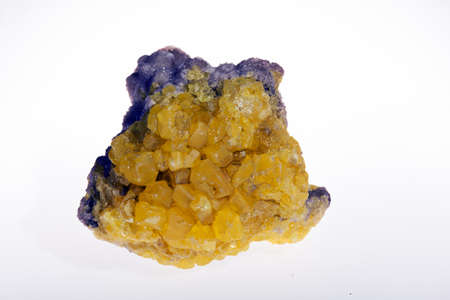 sulfur in the ore with a hint of violet on the white background