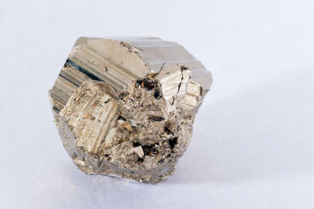 crystalline gold: pyrites, mineral from the group of sulfides on the white background