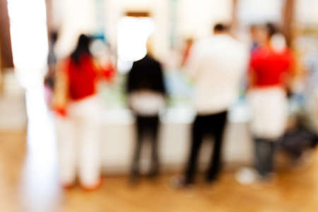 showpiece: Group of people gathered around showpiece at technology expo; blurred 100% Stock Photo