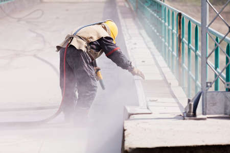 blasting of concrete, note shallow depth of field Stock Photo - 85022358