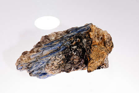 kyanite- disten  mineral with garnets on the white background Stock Photo