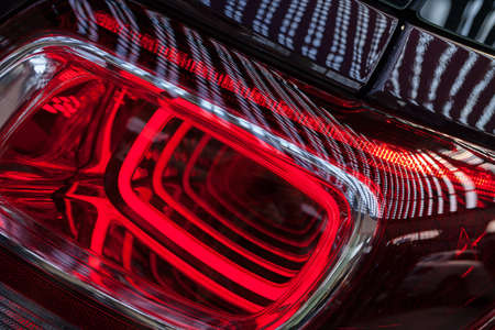 abstract red light from headlights on the car, not shallow depth of field