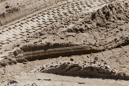 sand quarry: tire tracks in the sand, note shallow depth of field