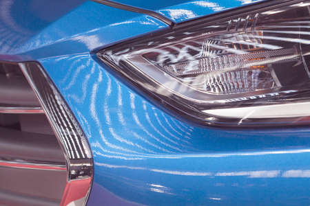 type headlights of the blue vehicle, note shallow depth of field Standard-Bild