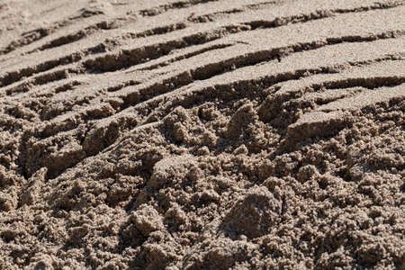 sand quarry: sand in construction, note shallow depth of field