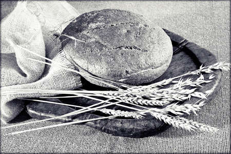 Decoration  with round integral bread on wooden board, note shallow depth of field
