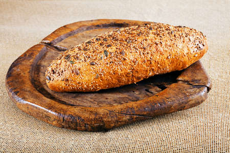 bread with seeds on the wooden board