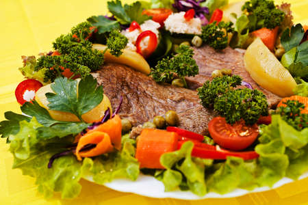 beef steak decorated with lots of vegetables