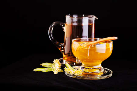 linden tea with  honey on the black background Stock Photo