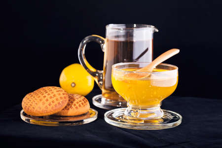 tilo: linden tea with  honey, lemon and gingerbread on the black background