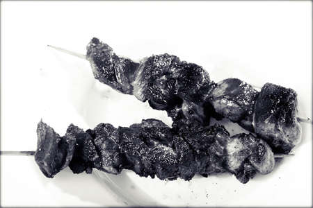 dept: skewers on the white background, note shallow dept of field
