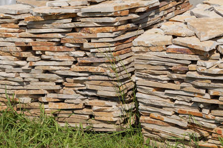 pile of stone blocks on the grass, note shallow depth of field Standard-Bild