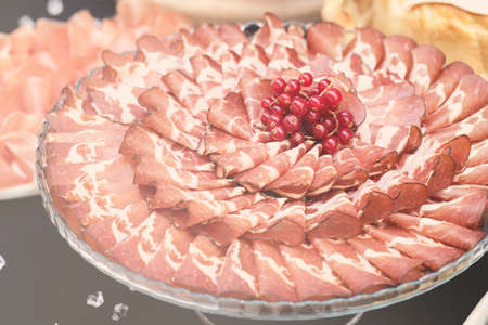 ham decorated with cranberries