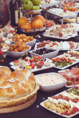 decorated Swedish table with a variety of good food, note shallow depth of field