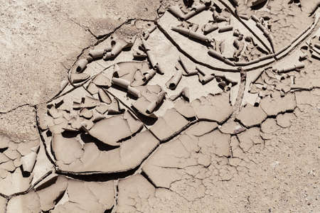 Trail of the dried and cracked mud in nature, note shallow depth of field