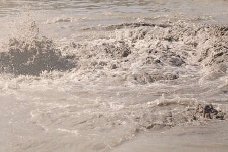 sand and mud in industrial water, note shallow depth of field