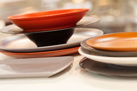 ceramic dishes in  colors for the kitchen or restoran, note shallow depth of field