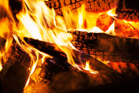 burning wooden logs in the fireplace, note shallow depth of field Stock Photo