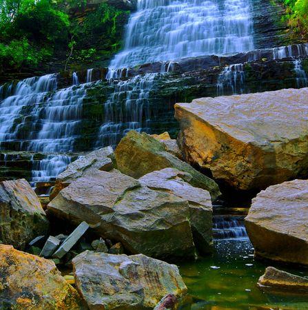 jagged: Water cascade onto jagged rocks Stock Photo