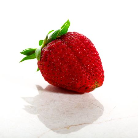 Delicious strawberry isolated on white with a marble base in high key Stock Photo - 7180306