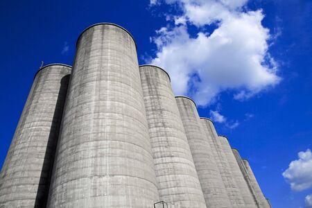 Concrete silos against a deep blue sky Stock Photo - 7231924