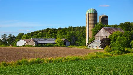 Older farm and field in spring Stock Photo - 7333957