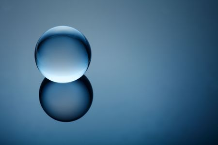 Clear crystal ball on blue gradient photo