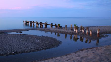 stoney point: Pier, tidepool and Lake Ontario in evening Stock Photo