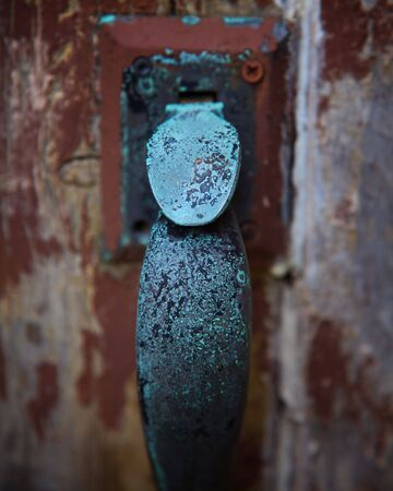 Selective Focus on Weathered Church Door Handle photo