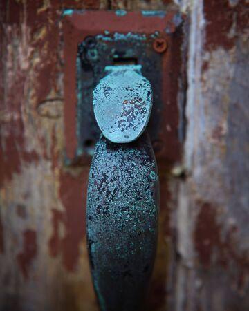 Selective Focus on Weathered Church Door Handle
