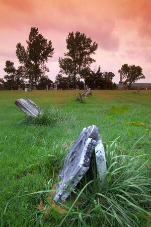 Unmarked graves in a surrealist setting Stock Photo